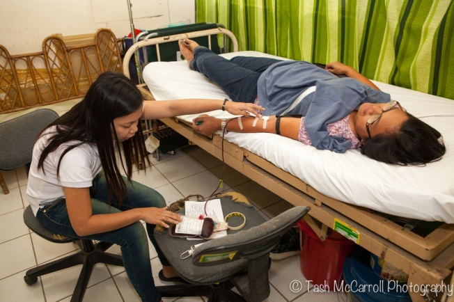 Giving blood in Tacloban city. The blood was used immediately for a young mother who had just given birth. There was still a serious shortage of blood at the hospital even at this time (2 & a half months after Typhoon Yolanda)>