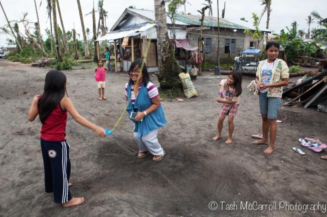 Ann sharing a fun moment with children in Luan Village