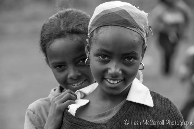 Peaking out, schoolgirls in Woliso, Ethiopia (September 2014)